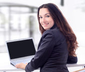 Thoughtful business woman for a laptop in the office with a smile. — Stock Photo