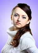 Beautiful girl in sweater. Isolated on a purple background. — Stock Photo