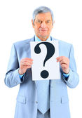 Nice businessman at the age, with a question mark. Isolated on a white background. — Stock Photo