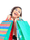 Portrait of a happy young adult girl, with color-coded bags — Stock Photo