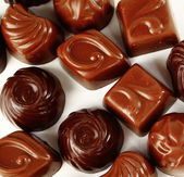 Closeup brown chocolate candy background — Stock Photo