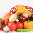 Composition with raw vegetables and wicker basket isolated on wh - Foto Stock