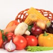 Composition with raw vegetables and wicker basket isolated on wh — Stock Photo #17700805