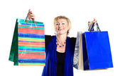 Beautiful woman in a campaign behind purchases. — Stock Photo