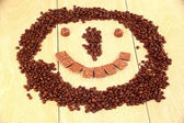Smiley of coffee and chocolate. — Stock Photo