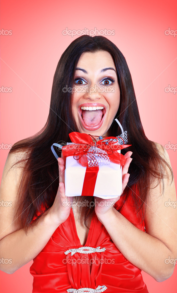 Beautiful girl with gifts.  Stock Photo #18123057