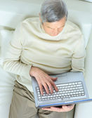 The home life of an elderly person. — Stock Photo