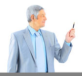 Nice businessman at the age, holds before his pen. Isolated on a white background. — Stock Photo