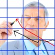 Royalty-Free Stock Photo: Businessman draws a graph. Isolated on a white background.