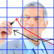 Businessman draws a graph. Isolated on a white background. - Stock Photo