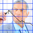 Businessman in age, draws a graph. Isolated on a white background. — Lizenzfreies Foto