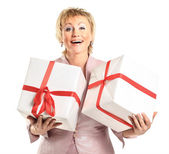A beautiful woman with gifts. — Stock Photo