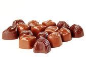 Brązowy cukierki czekoladowe tło zbliżenie — Zdjęcie stockowe