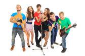 Musiker grupp spelar musikinstrument i en konsert som isolerad på vit bakgrund — Stockfoto