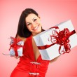 Stock Photo: Beautiful girl with Christmas presents.