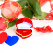 A rose and a box with rings - Foto Stock