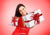 Beautiful girl with Christmas presents. — Stock Photo