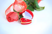 A rose and a box with rings — Stock Photo