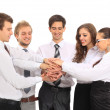 Business team putting their hands on top of each other — Stock Photo #19031339