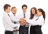 Business team putting their hands on top of each other — Stock Photo