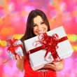 Beautiful girl with Christmas presents. - Foto Stock