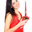 Stockfoto: A beautiful girl with a candle.