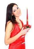 A beautiful girl with a candle. — Stock Photo