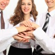 Business team putting their hands on top of each other — Stock Photo #19436529
