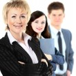 Confident business woman with team behind her — Stock Photo #19438125