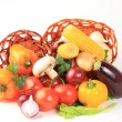 Composition with raw vegetables and wicker basket isolated on wh — Stock Photo #19438549
