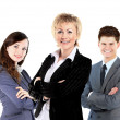 Royalty-Free Stock Photo: Confident business woman with team behind her