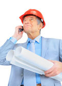 Engineer at the age of, talking on the phone. Isolated on a white background. — Stock Photo