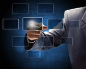 Businessman hand pressing a button on a touch screen interface — Stock Photo
