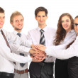 Business team putting their hands on top of each other — Stock Photo #19620835