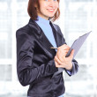 Nice business woman with the documents in the office. - Stock Photo