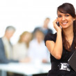 Confident business woman with team behind her — Stock Photo #19624663