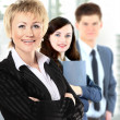 Confident business woman with team behind her — Stock Photo #19624945