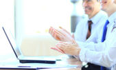 Cropped image of business clapping hands during meeting at office — Stock Photo