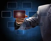 商人手触摸屏幕界面上的一个按钮 — 图库照片