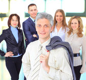 Happy business man with colleagues — Stock fotografie