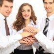 Business team putting their hands on top of each other — Stock Photo #19785133
