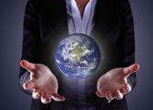 Business hand holding globe — Stock Photo
