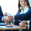 Mature businessman shaking hands to seal a deal with his partner and colleagues in a modern office — Stock Photo #21782305
