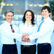 business team putting their hands on top of each other — Stok fotoğraf