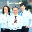Successful business group in a row smiling   — Stock Photo