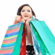 Happy young adult girl, with color-coded bags. - Stock Photo