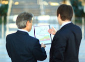 Image of smart boss explaining to colleague business idea — Stock Photo