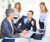Group of businessmen the conclusion of the transaction — Stock Photo