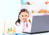 Cute little girl smiling and looking at laptop,Little girl using laptop — Stockfoto
