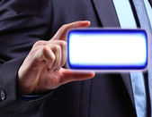 Hand Keeping a button on touch screen — Stock Photo